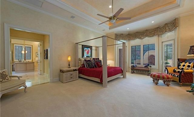 Master Bedroom overlooking private fountain and pool area.