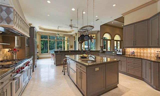 Chef's kitchen with state-of-the-art appliances, ample seating a