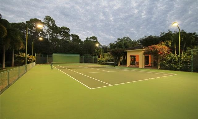 Lighted tennis court and pavilion.